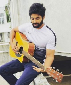 Cook with Comali Ashwin with his guitar