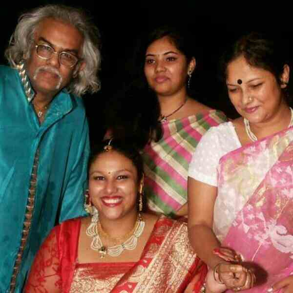Mou Bhattacharya With Husband and Daughters Family Photo